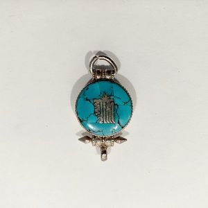 Stamped silver pendant with turquoise inlay.